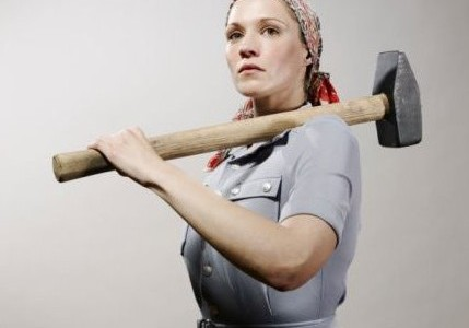 One of the few non-sexist pictures of woman with a sledgehammer on the internet.  Seriously, no one in their right mind would knock down a wall in a fucking bikini.